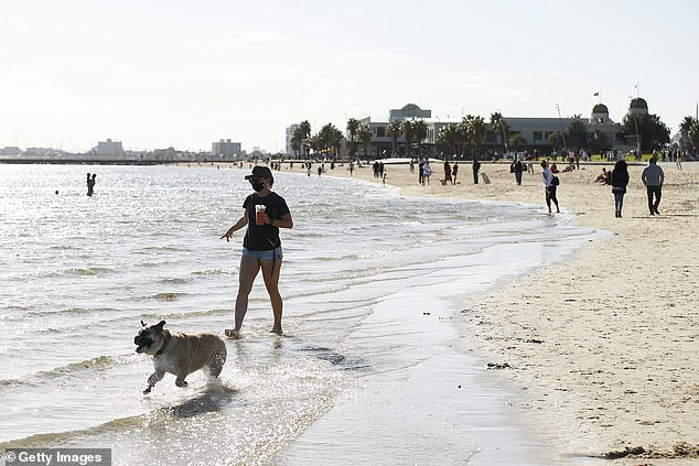 Melburnians will have their exercise time doubled from one hour to two from September 13. Pictured is a Melburnian taking their dog for a walk along the St Kilda foreshore on Sunday