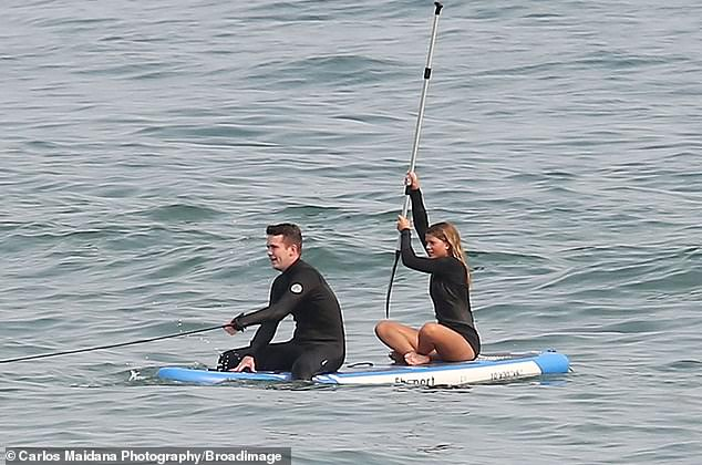 Total pro: The model had the paddle in hand and maneuvered herself and her pal around the open water effortlessly