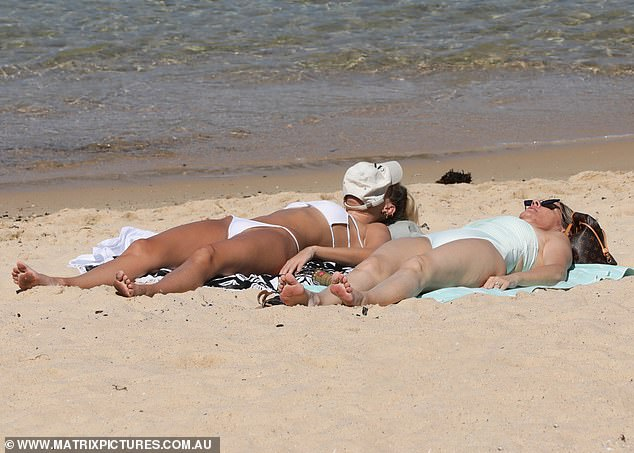 Girls just wanna have sun: Showing off her lithe frame, the former Miss Universe Australia 2008 made the most of the warming weather, basking in the sunshine alongside her mother