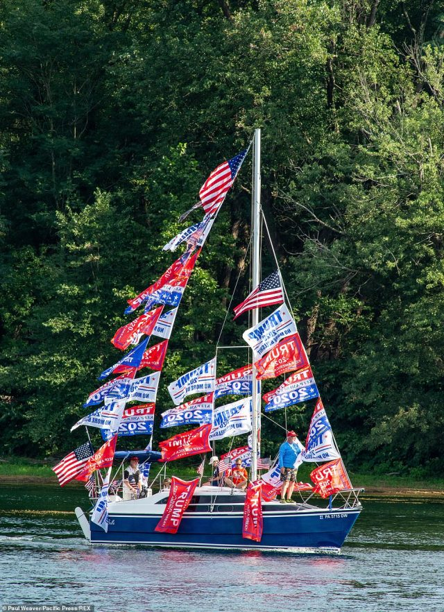 A boat decked out in Trump flags takes part in a pro-Trump boat parade in Pennsylvania