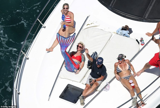 In Florida, sunbathers wearing US swimming costumes and even a mermaid's tail enjoyed their Labor Day on the waters