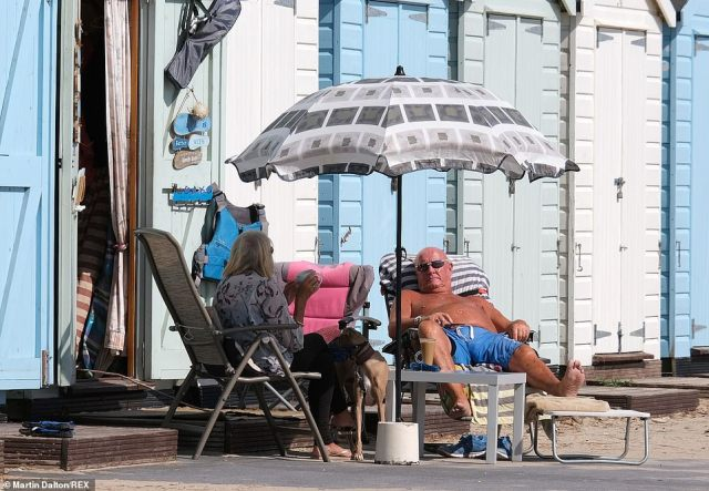 People basked in the sunshine in Mudeford, Dorset, yesterday as showers began to slow down and leave most parts dry with clear spells
