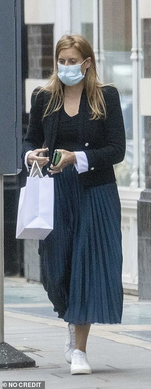 The royal paired a trendy navy midi skirt with a black military style jacket as she stepped out for the shopping trip earlier today