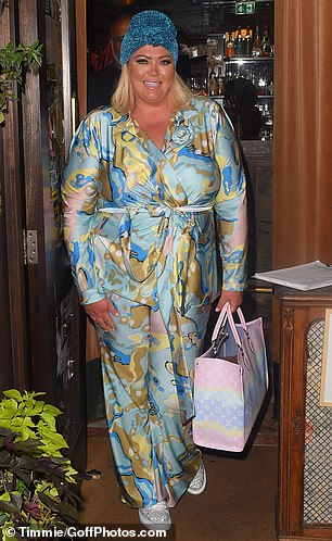 Work it: Gemma commanded attention as she showed off her slimmed-down figure in a blue patterned satin blazer and trouser combo