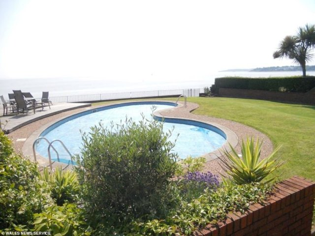 Not bad: A heated outdoor pool offers the prospective tenant  prime views of the stunning Glamorgan coastline