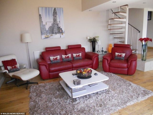 Patriotic: The deep red flourishes and cushions bearing the Welsh dragon reference the bungalow's geographic location