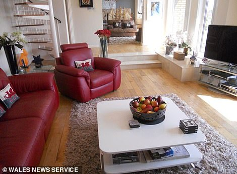Not bad: Inside, the property is fully furnished with brown and red leather sofas dominating two separate living areas - giving potential tenants plenty of space to relax and unwind