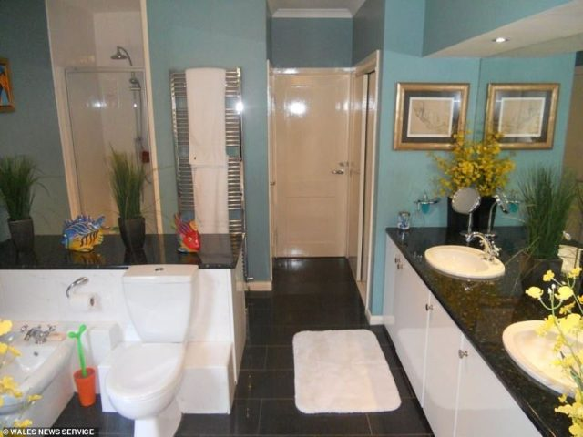 Plenty of room: Matching twin sinks take advantage of the master bathroom's considerable space