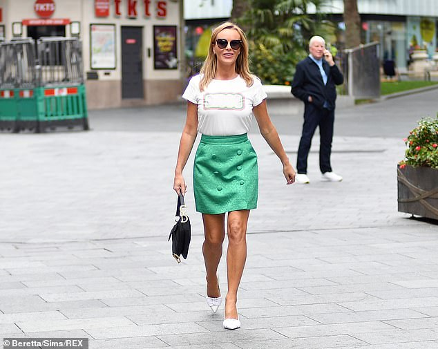 Lovely:She teamed the fun look with a stand-out 'disco' T-shirt and white heels which further highlighted her svelte physique