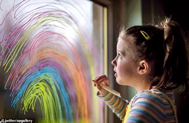 The final of the three images to be unveiled was a snap of a little girl painting a rainbow on a window pane