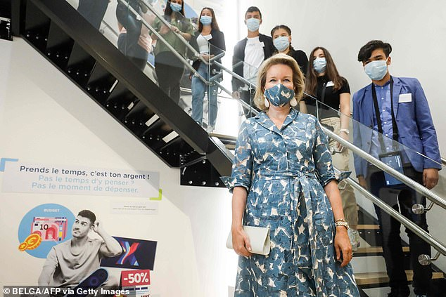 The mother-of-four  looked relaxed as she visited the centre with members of its staff and local teenagers, also all wearing masks