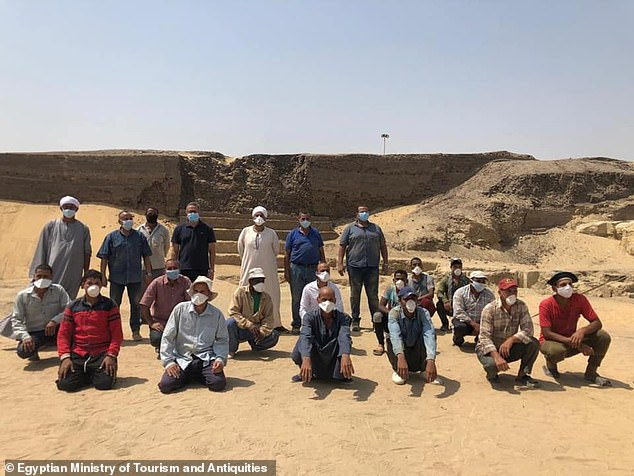 Experts believe that Saqqara was active as a burial site for around 3,000 years — and was used by both those of high social standing and the lower classes. Pictured, the researchers pose for a photograph at the necropolis site