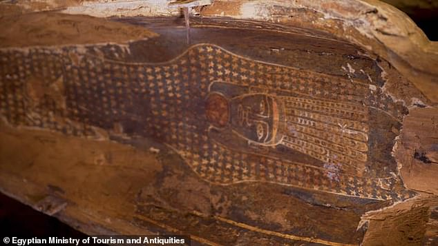 'An indescribable feeling when you witness a new archaeological discovery,' Mr Al-Anani wrote on Twitter, adding thanks to his colleagues. Pictured, the inside lid of one of the coffins