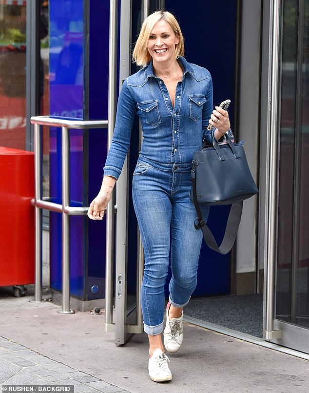 Looking good:Jenni Falconer took the divisive double denim look on step further by wearing a blue jean jumpsuit on Tuesday