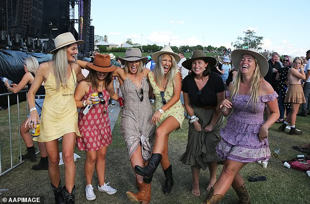 Australia's famous Tamworth Country Music Festival will not be held in 2021 due to COVID-19 concerns (pictured: attendees laugh among the crowd of Cold Chisel at the Tamworth Country Music Festival in January 2020)