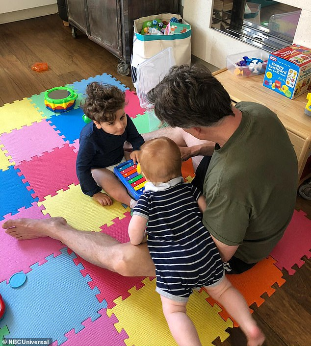 Loss: Henry, who cannot walk or talk,has been cut off from the therapies that enrich his life due to the pandemic. He is pictured playing with his father and baby brother, Theo
