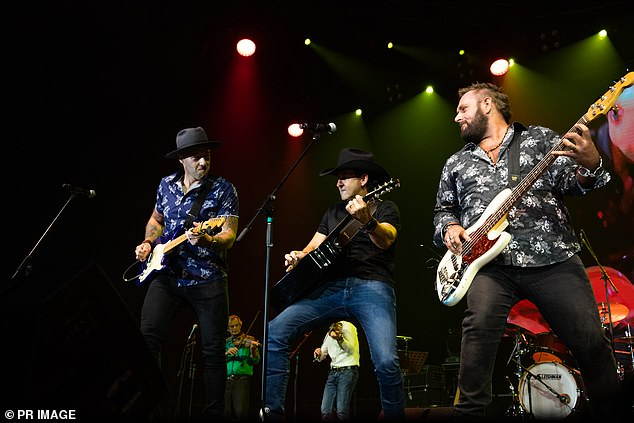 The iconic festival started in 1973, and the 2021 was due to mark its 49th continuous year (Pictured: The Wolfe Brothers - Nick (left) and Tom (right) - playing with Lee Kernaghan (centre) at the 2020 Tamworth Country Music Festival)