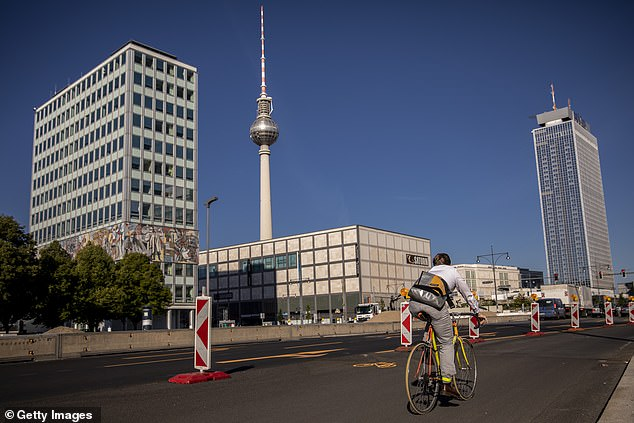 A cyclist uses a pop-up road during their morning commute near Alexander Platz in Berlin, Germany. Berlin's administrative court has ordered the removal of some of Berlin's pop-up cycle lanes