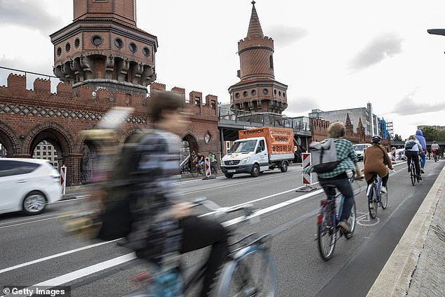 The court also ruled that the coronavirus pandemic was 'not a traffic relevant consideration'. Pictured:Cyclists use a 'pop up' bike road near Oberbaum Bridge in Berlin