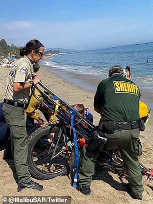 The Sheriff¿s department posted Sunday about saving a 22-year-old woman who ¿lost consciousness¿ at the beach, sharing photos of first responders transporting her away for medical attention.