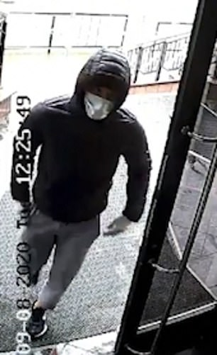 Video surveillance images showed a masked man wearing a hooded coat
