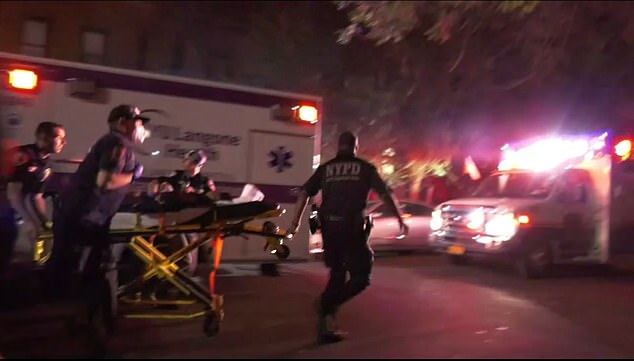 EMTs race to recover people from the Caribbean festival in Brooklyn on Saturday night where many were shot