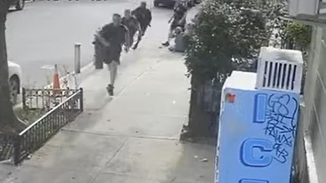 The incident took place in front of a fire station. Seconds after the assault, four firefighters are seen giving chase