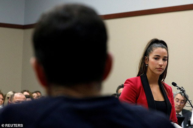 Using her voice: Raisman is pictured speaking at the sentencing hearing for Nassar in 2018. The Olympian is one of the hundreds of women and girls who accused him of sexual assault