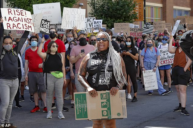 Craft leads chants at a Black Lives Matter rally on June 6 in Pittsburgh
