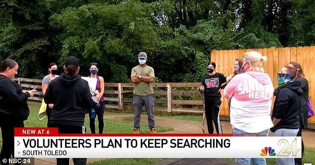 Volunteers are seen on Monday searching for Braylen around his family's apartment complexon Gibraltar Heights Drive, just steps away from the pool