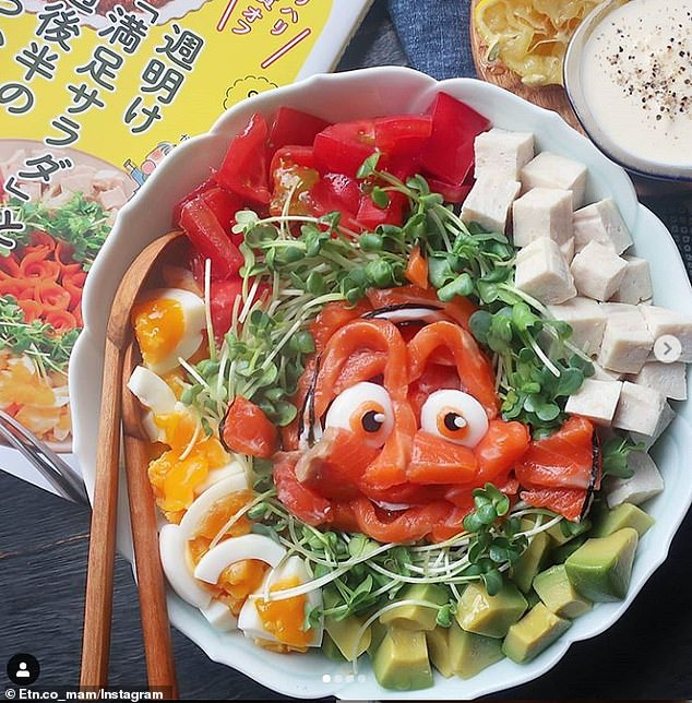 Made out of kiwi, melons and even eggs, the food entertains Etoni's three children, aged 12, 10, and 8 - with her middle daughter previously being a picky eater. Pictured, the Disney character Nemo created using salmon