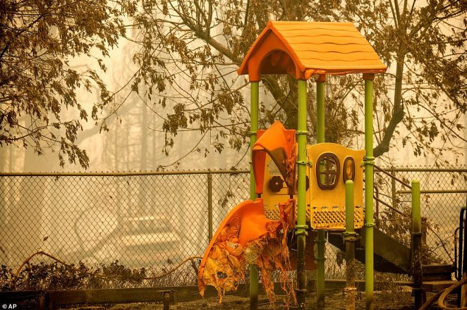 A melted slide stands in the playground at the Pine Ridge School in Fresno County after the Creek Fire tore through Tuesday
