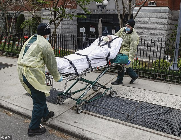 After initially being hit hard by the COVID-19 pandemic in March, April and May, New York City managed to flatten the curve. Pictured: a coronavirus patient is pictured being loaded into an ambulance at the peak of the pandemic on April 17
