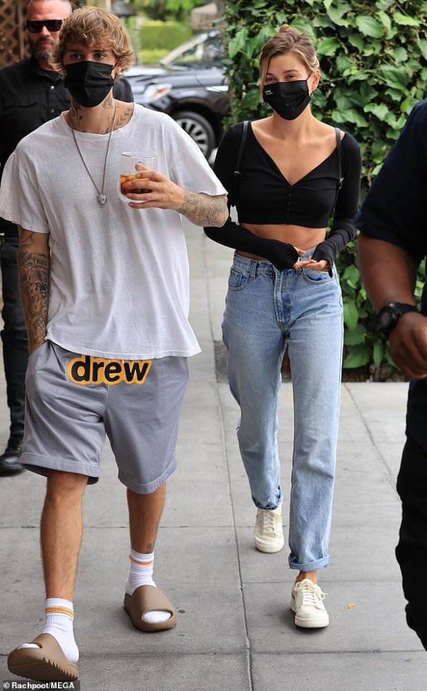 Lunch: Justin Bieber showed off his new neck tattoo while carrying wife Hailey for lunch at Il Pastayo in Beverly Hills on Tuesday.