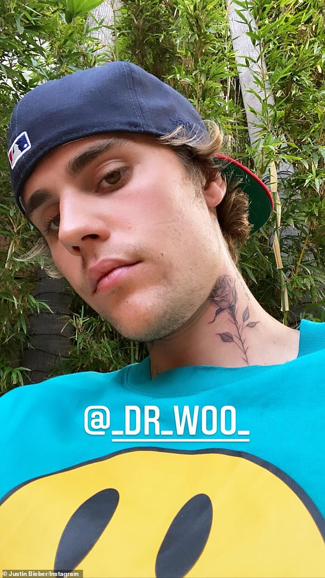 New addition:Bieber paid a visit to his favorite tattoo artist Dr. Woo on Monday afternoon