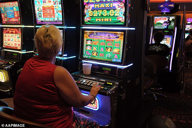 Australians have lost a massive $800million on poker machines in the last two months alone despite social distancing rules limiting the number of people allowed inside at any one time (woman pictures on a poker machine)