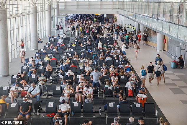 Britons could be forced to quarantine or take Covid-19 tests when travelling to EU countries, and might even be banned from Europe as a whole if infections continue to rise. Pictured: Departures at Croatia's Split Airport