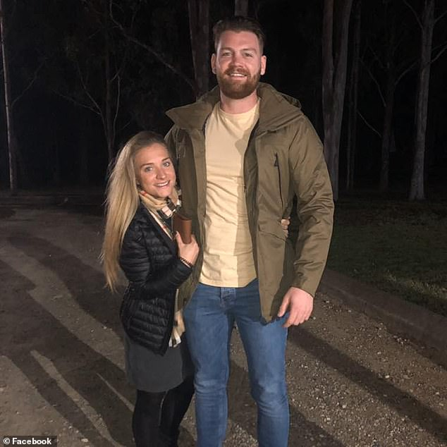 A tiny but fiery Hendrie (left) reacted after her towering fiance was knocked to the ground