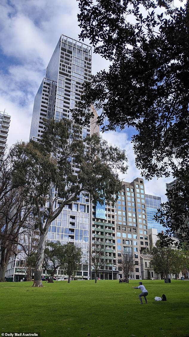 A person exercises in the gardens across the road from the Sofitel hotel in Melbourne on Wednesday
