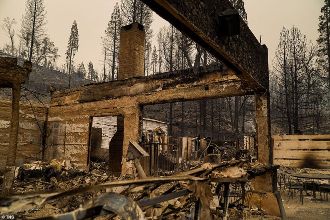 The smoldering remains of Cressman's General Store and Gas Station along CA-168, pictured on Tuesday after the Creek Fire