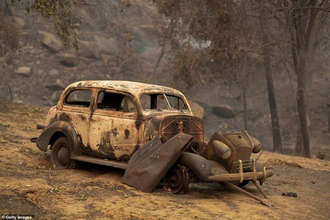 A burned car sits completely destroyed after the Creek Fire swept through 152,833 acres of forests