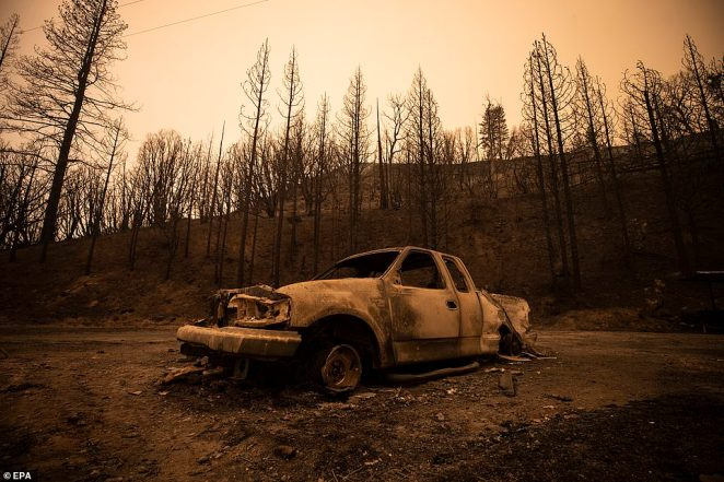 The burnt wreckage of a car is pictured on Tuesday near Shaver Lake in northern California, after the Creek Fire