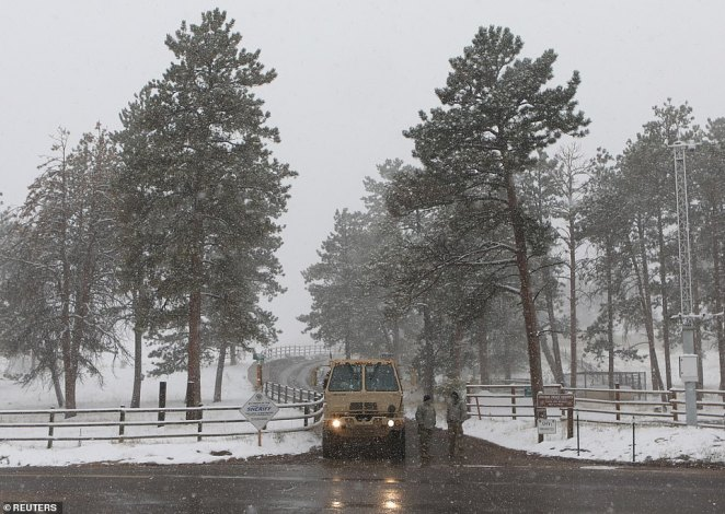 The Cameron Peak wildfire, near Fort Collins, Colorado, was blanketing Denver in orange haze until snow fell on Tuesday