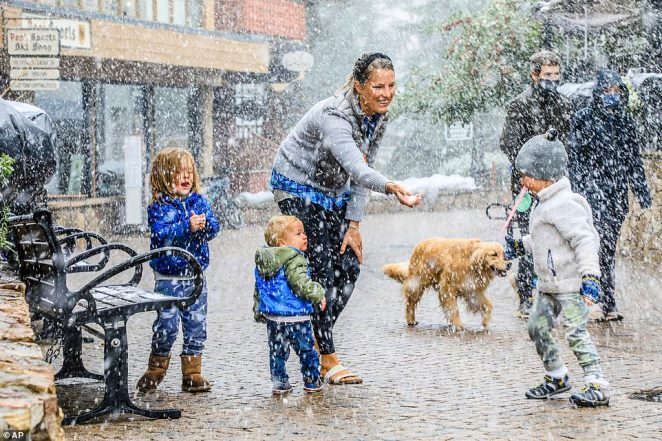 Megan Dillard plays in the snow in Vail, Colorado on Tuesday with, from left, Sammy, 4; Hayes, 1; and Donald, aged 3