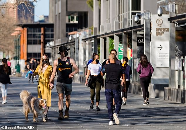 Melburnians pictured wearing face masks on August 29 as the state battles through a second wave of COVID-19