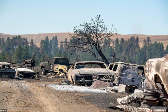 Vehicles destroyed by a wildfire are shown on Tuesday in Malden, Washington