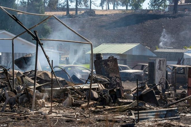 The smoldering wreckage of a home and yard is pictured in Malden, Washington, on Tuesday