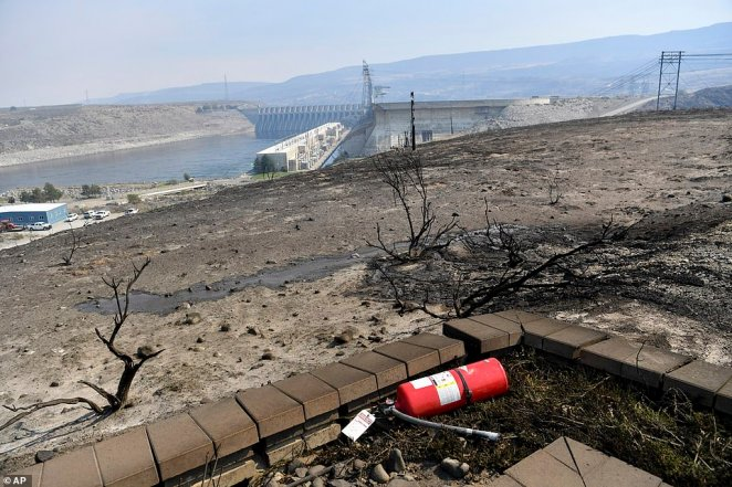 A fire extinguisher is pictured at a scenic overlook above Chief Joseph Dam after the Pearl Hill Fire roared through Monday