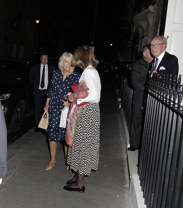 The royal looked in high spirits as she engaged in conversation with friends at the private members club