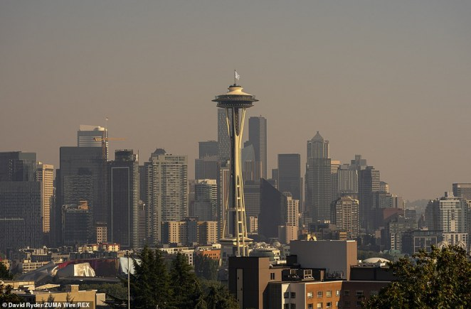 Heavy smoke from wildfires cloaks the Seattle skyline on Tuesday